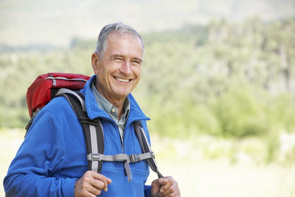 Portrait,Of,Senior,Man,On,Hike